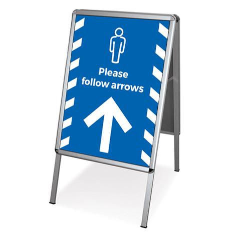 Please follow the arrows pavement sign