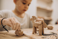 cute-boy-forming-toys-from-clay.jpg
