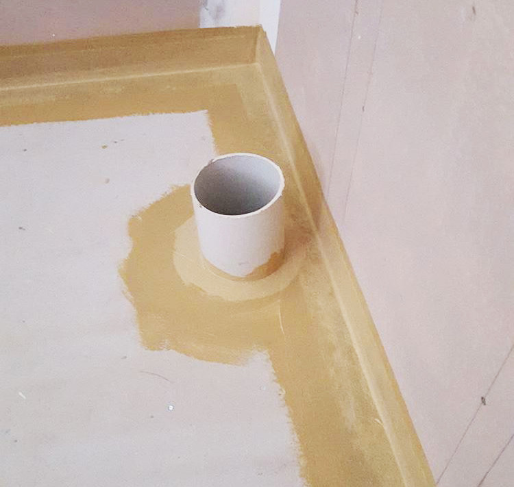 start with the agent around the wall and floor area then roller the whole of the floor and up to 1.8m high in shower area