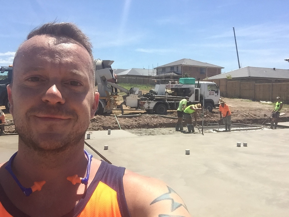 TV presenter Walt Collins on site pouring the slab