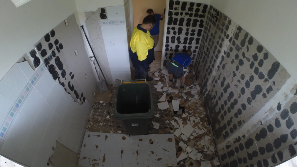 Waterproofing a bathroom - make sure you clean all of the dirt away first
