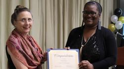 Ginny Mangum awards a council award