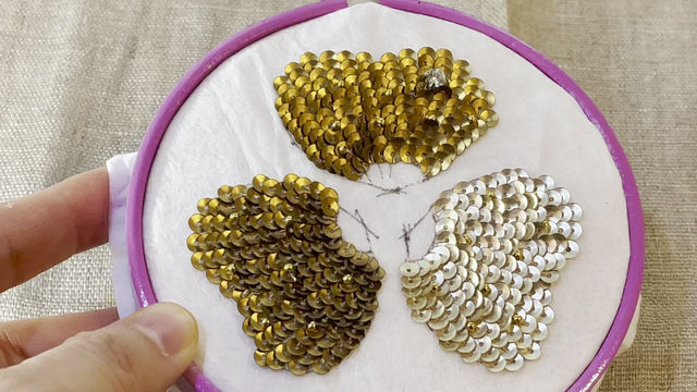 Hand sewing flowers with spangles