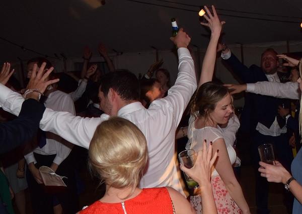 Marquee wedding celebration in full swing, DJ Jules, Wedding DJ London