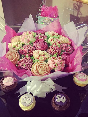 A stunning cupcake bouquet with matching