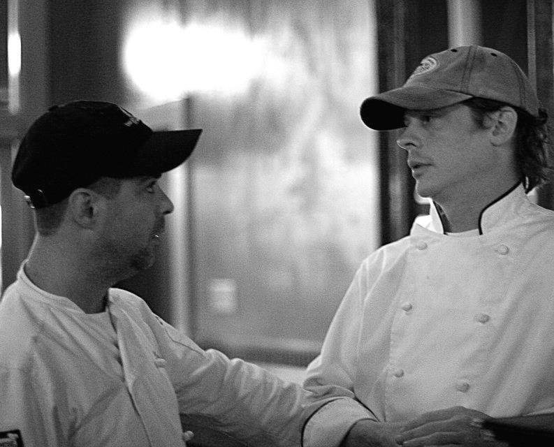 Mike Caudill talking with another Table 50 Chef
