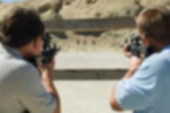men-aiming-rifles-firing-range-29660176.