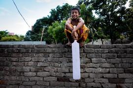 Young Cricketer. Dhaka slum.