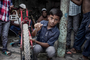 Child worker. Bicycle mechanic.