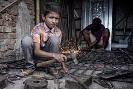 Child worker. Trainee welder.