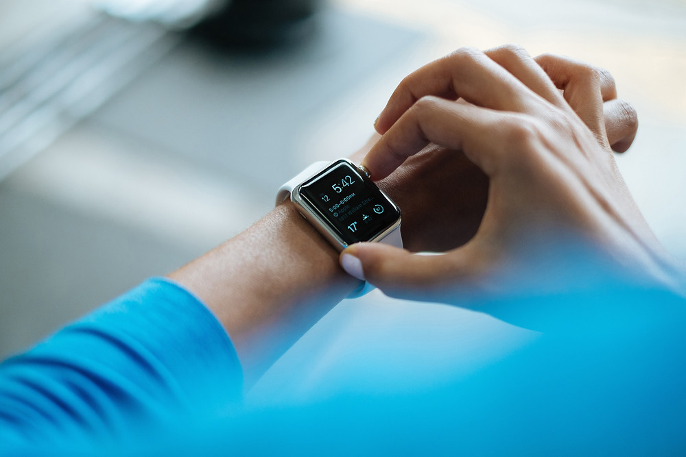 A person using a smartwatch