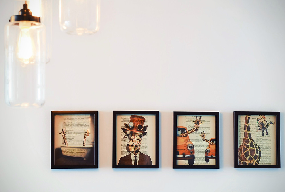 A variety of attractive, modern art pieces on a wall