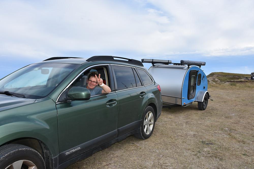Editor in her Subaru towing her blue teardrop trailer