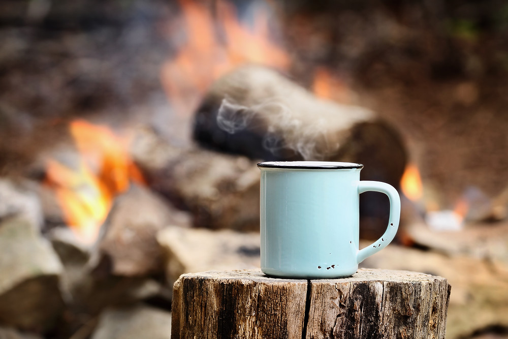 a cup of coffee at the campfire