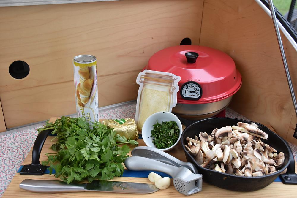 Mushroom galette ingredients sitting in galley of teardrop camper