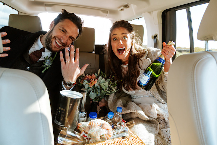 Cheers to the newlyeds! A&E just married about to drive around Thingvellir national park with their Pink Iceland Wedding planner & Kristopher Orr, their Iceland Wedding photographer