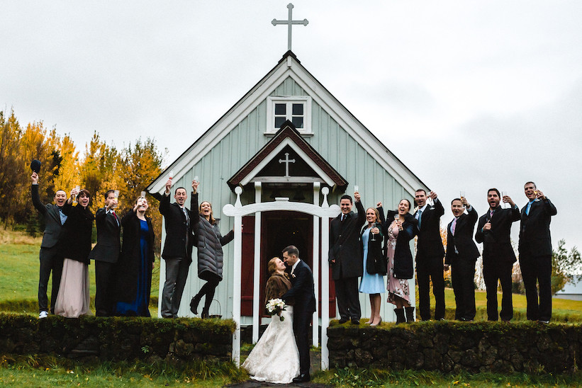 Iceland Wedding photo by Kristin Maria of newlyweds outside Skogar Church
