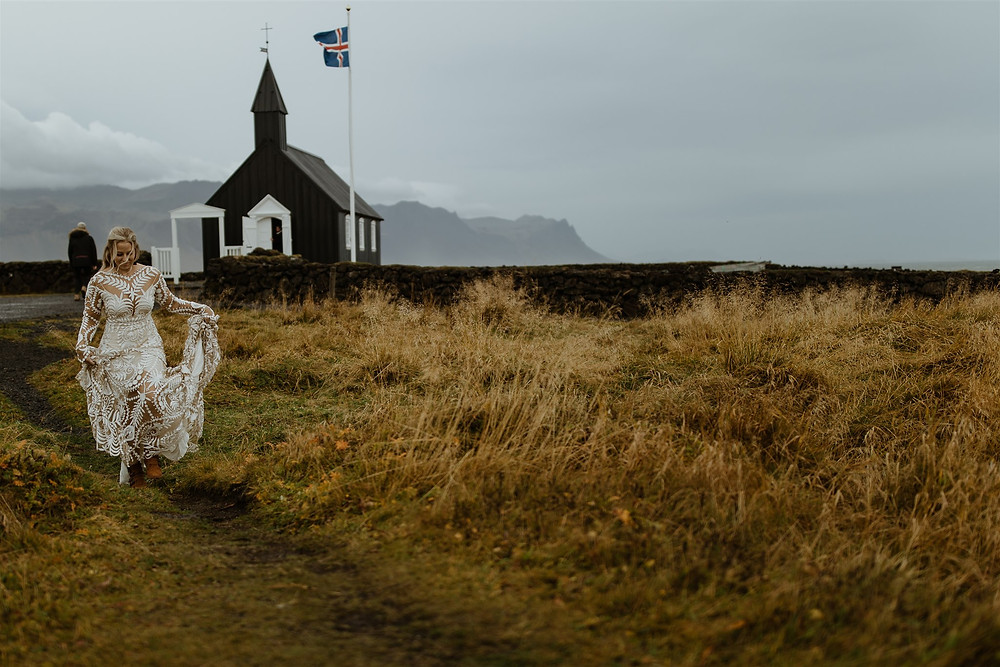 First look in Budir Lava Field before their Wedding Ceremony in Budir Black Church. Photo by Styrmir & Heiddis