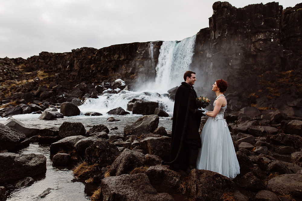Game of Thrones themed wedding in Thingvellir National Park. Wedding photo at Oxararfoss waterfall