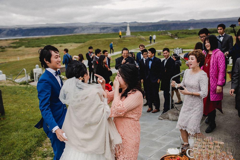 Wedding couple outside Strandakirkja church in Iceland