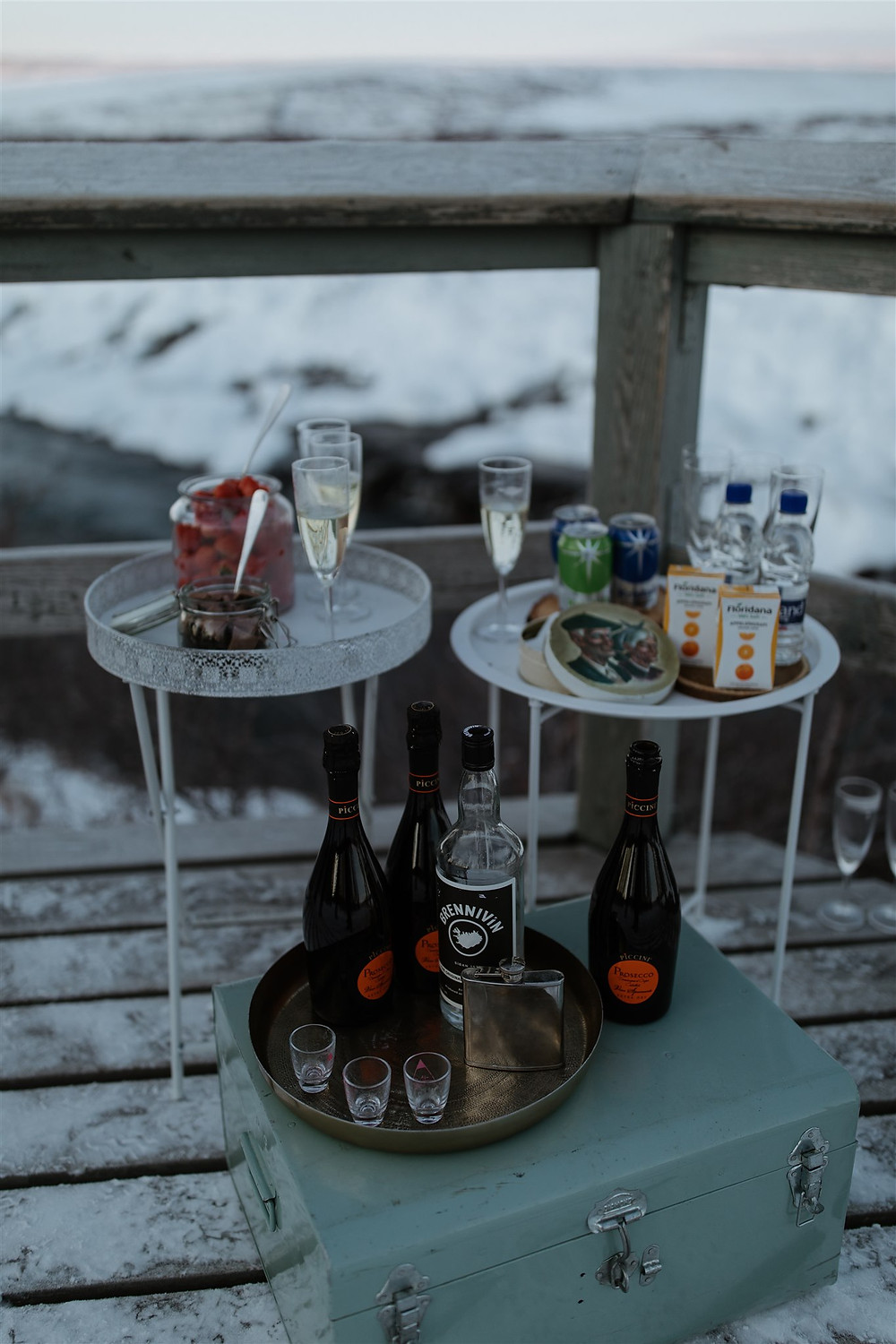 Iceland Winter Wedding prosecco picnic by Hraunfossar