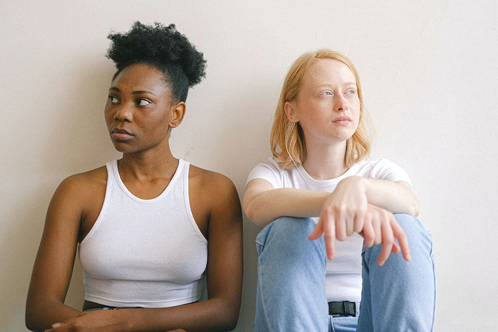 Two girls discussing relationship boundaries - The Collective