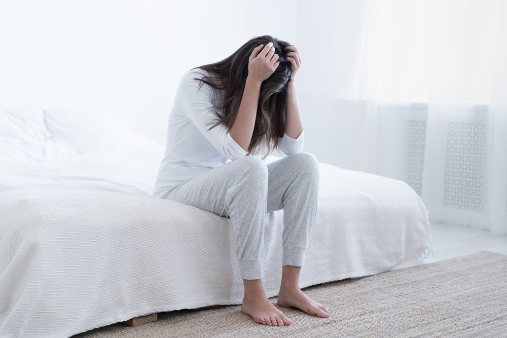 Woman with anxiety in bed