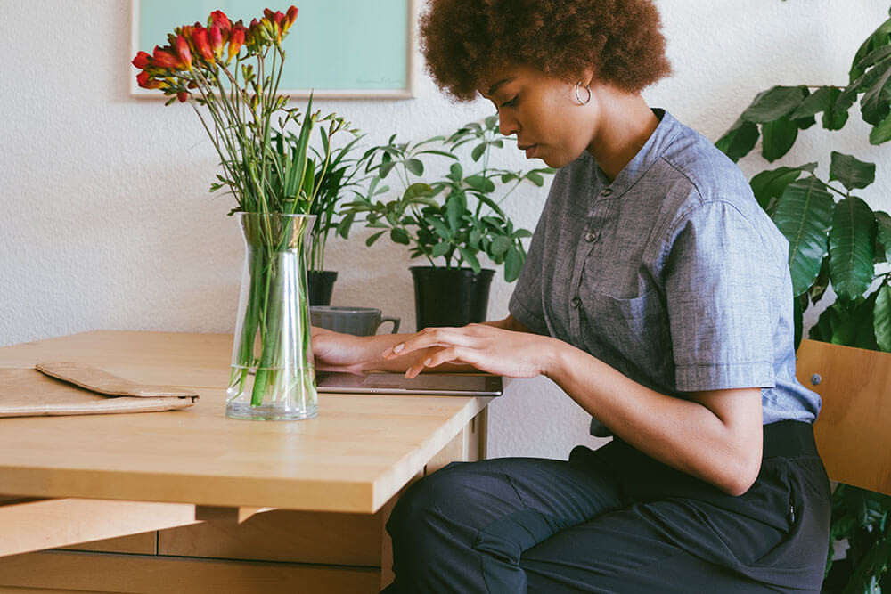Woman working from home - The Collective
