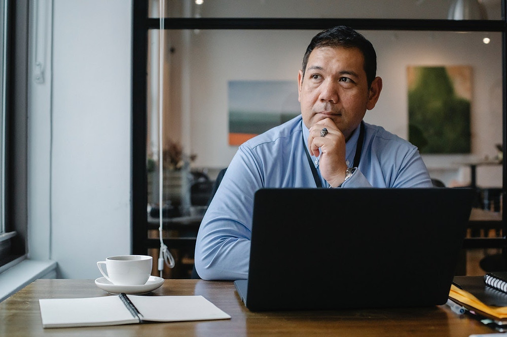 Man working at a desk with identity issues