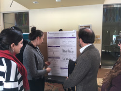 Margarita and Gaby presenting our poster