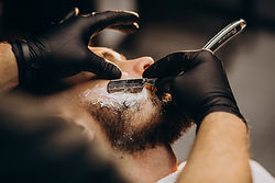 handsome-man-cutting-beard-barber-salon_