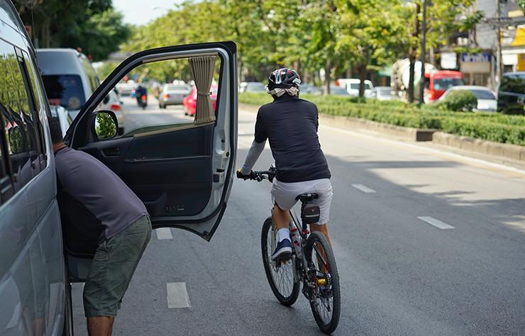 Car door opening next to biker
