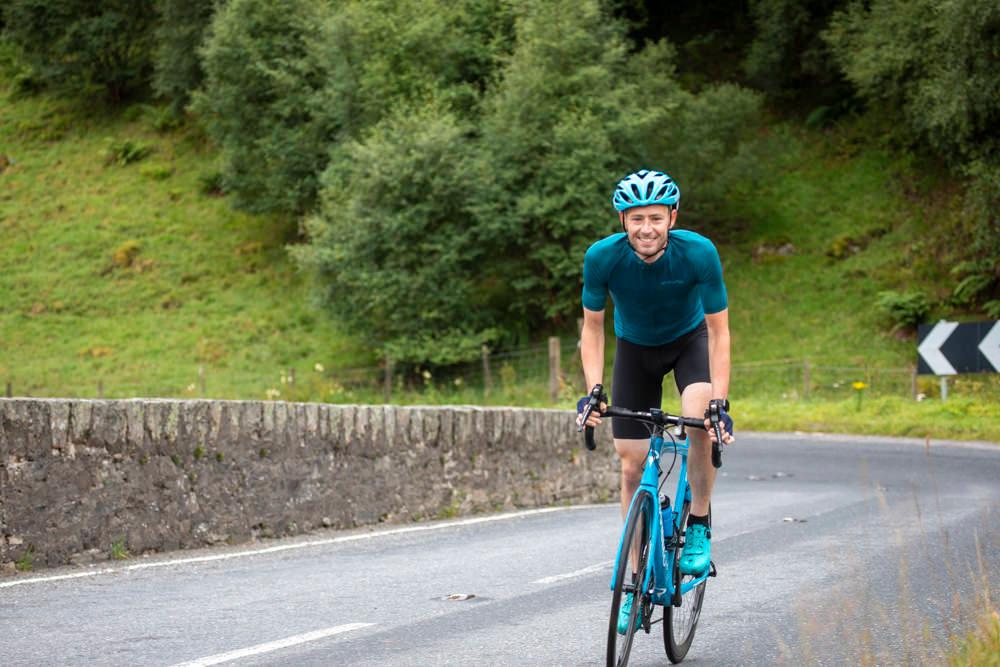 Josh Quigley riding his bicycle