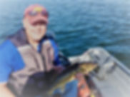 Mike proudly displaying his first walleye with his Crow River Custom Rod