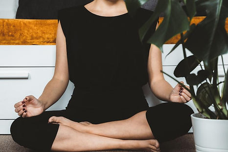 person-sits-in-a-calm-meditation-pose.jp