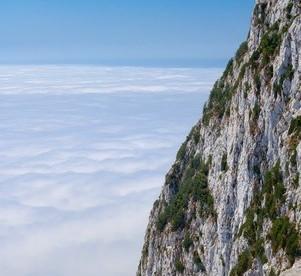 Climbing the cliff face