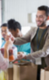volunteers-handing-out-food_edited.jpg