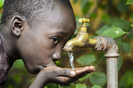 Water is Life! African Baby Boy Drinking
