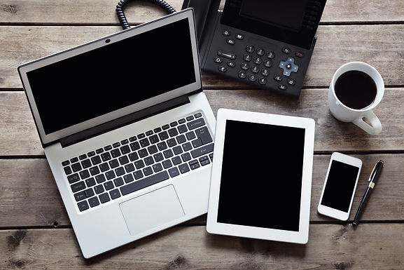 open-laptop-with-white-digital-tablet-an