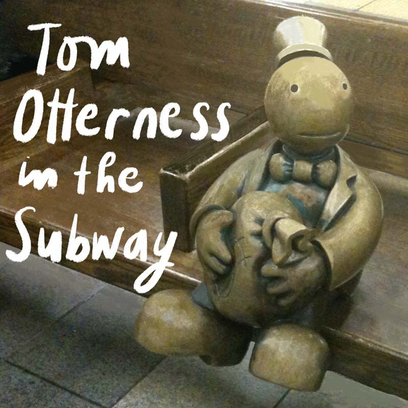 Tom Otterness brass sculpture in the 14th Street A-line subway