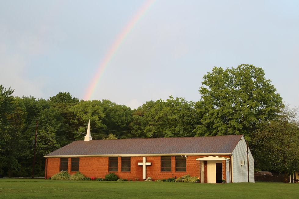 Church with rainbow above