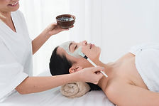 woman-with-facial-mask-spa_23-2148206224