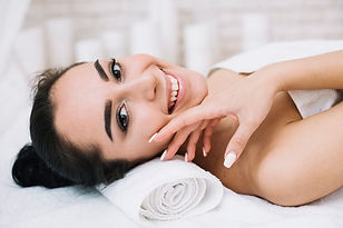 woman-receiving-relaxing-facial-massage_
