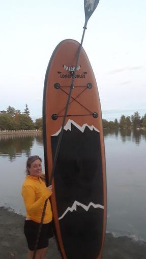 flp shandra holding flp board vertically.jpg
