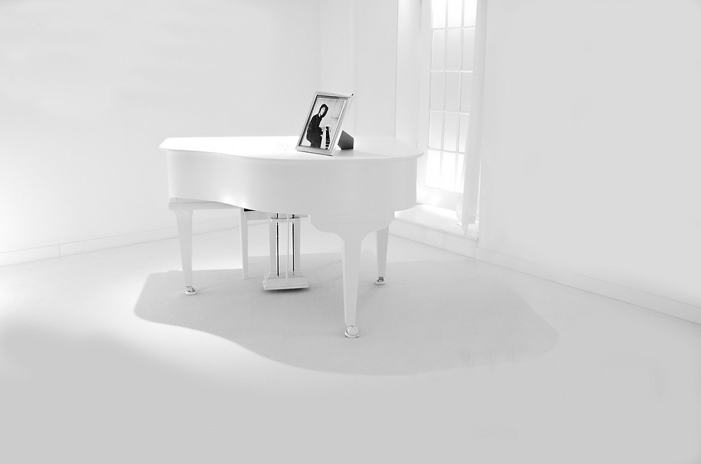 White Acoustic Grand Piano