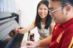 Teacher Genell Giving Piano Lessons