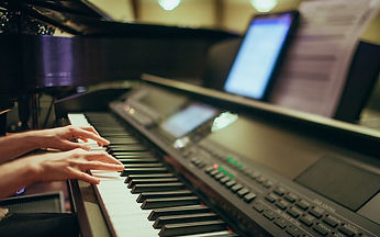 Adult Playing Piano