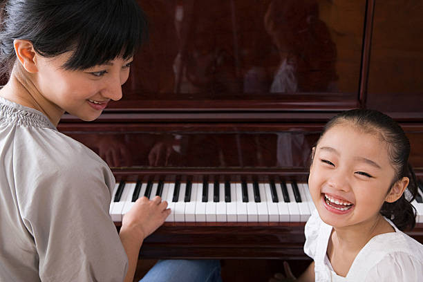 Girl learning piano