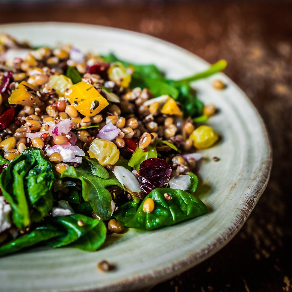 Healthy salad with spinach,quinoa and ro