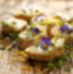 Canapes with edible flowers and broad be